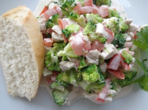 Broccoli and chicken salad serve with French stick.